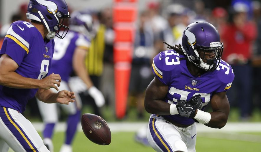 Minnesota Vikings quarterback Sam Bradford, left, fumbles the ball in front of running back Dalvin Cook during the first half of an NFL preseason football game against the San Francisco 49ers, Sunday, Aug. 27, 2017, in Minneapolis. (AP Photo/Jim Mone)