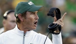 FILE - In this Sept. 12, 2015, file photo, Baylor coach Art Briles yells from the sideline during the first half of an NCAA college football game against Lamar in Waco, Texas. The Canadian Football League and Hamilton Tiger-Cats say Briles will not be joining the team as an assistant coach after all. Less than 12 hours after the Tiger-Cats announced that Briles would be joining head coach June Jones' staff as assistant head coach of offense, the league and team respond to public backlash and let the 61-year-old coach go. (AP Photo/LM Otero, File)