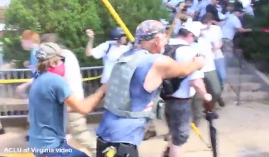 """A man seen in a now-viral video firing a gun at a crowd of counterprotesters during """"Unite the Right"""" clashes in Charlottesville, Virginia, earlier this month has been arrested. (Twitter/@ACLUVA)"""