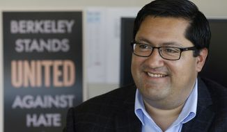 Berkeley Mayor Jesse Arreguin poses for photos in his office while being interviewed in Berkeley, Calif., Monday, Aug. 28, 2017. An anti-hate rally on Sunday was disrupted when scores of anarchists wearing black clothing and masks stormed the demonstration in Berkeley and attacked several supporters of President Donald Trump. But police were able to head off any wider violence. (AP Photo/Jeff Chiu)