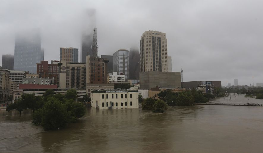 Floodwaters from Tropical Storm Harvey flow in the Buffalo Bayou in downtown Houston, Texas, Monday, Aug. 28, 2017. (AP Photo/LM Otero)