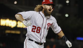 Washington Nationals Jayson Werth begins to celebrate after hitting a two-run homer against the Miami Marlins starting pitcher Jose Urena during the fourth inning of a baseball game at Nationals Park, Monday, Aug. 28, 2017, in Washington. (AP Photo/Pablo Martinez Monsivais)