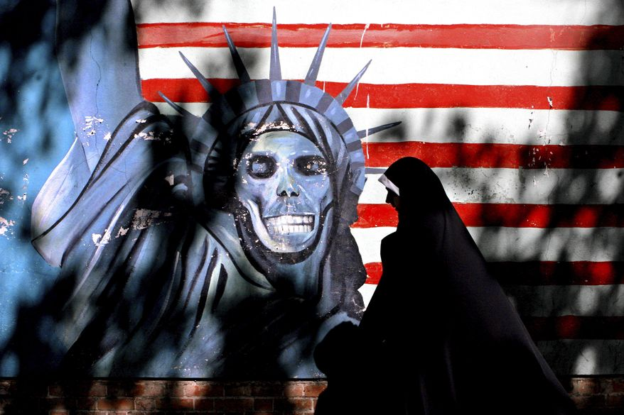 Graffiti art characterizing the Statue of Liberty is painted on the wall of the former U.S. Embassy in Tehran. Iranian-American businessman Siamak Namazi and his 81-year-old father, Baquer, are among several dual nationals detained in Iran. They learned last week that they had lost an appeal. (Associated Press/File)