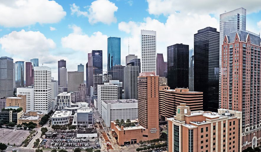Houston skyline (Photo by Henry Han via Wikipedia)