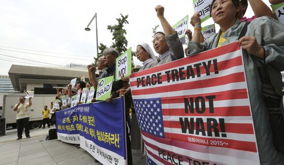 South Korean protesters stage a rally against the deployment of an advanced U.S. missile defense system called Terminal High-Altitude Area Defense, or THAAD, near the U.S. embassy in Seoul, South Korea, Monday, Aug. 28, 2017. North Korea fired several rockets into the sea Saturday in the continuation of its rapid nuclear and missile expansion, prompting South Korea to press ahead with military drills involving U.S. troops that have angered Pyongyang. (AP Photo/Ahn Young-joon)