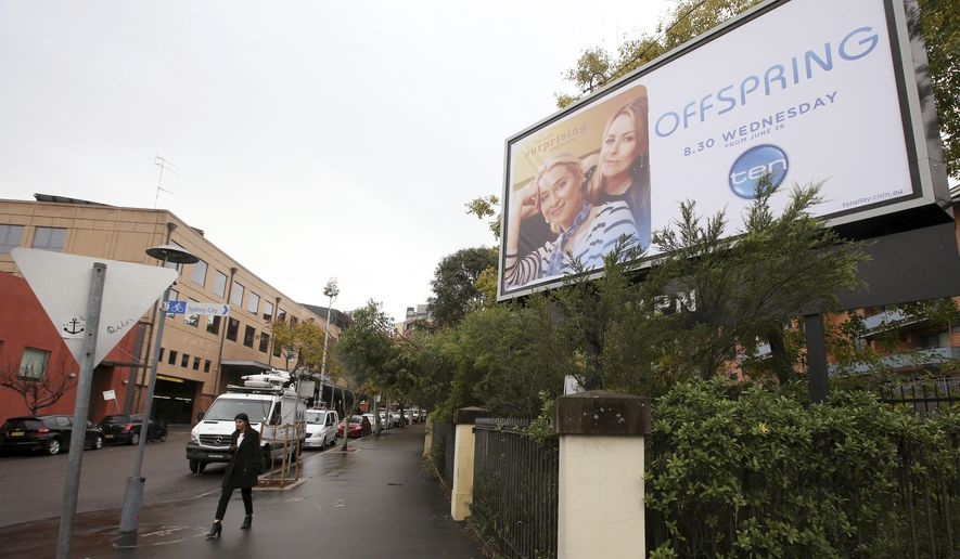 FILE - In this June 14, 2017 file photo, a billboard advertising a television show is displayed near the offices of the Ten Network in Sydney. Troubled Australian television broadcaster Ten Network will be sold to U.S. giant CBS Corp. subject to regulatory approval of foreign ownership, the Sydney-based company's administrator said on Monday, Aug. 28, 2017. (AP Photo/Rick Rycroft, File)