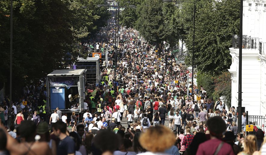Crowds attend the Family Day at the Notting Hill Carnival in west London, Sunday Aug. 27, 2017. The police presence in London has been stepped up because of the holiday weekend and the annual Notting Hill Carnival, a busy weekend street festival that attracts huge crowds. (Yui Mok/PA via AP)
