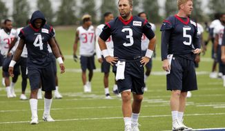 Houston Texans quarterbacks Deshaun Watson (4), Tom Savage (3) and Brandon Weeden (5) take a breather from running sprints during a morning practice at the Dallas Cowboys training facility, Monday, Aug. 28, 2017, in Frisco, Texas. The Texans are working out in the practice facility of the Dallas Cowboys because of floods pounding Houston. An exhibition game in the Texans' stadium Thursday might be moved to the home of the Cowboys. (AP Photo/Tony Gutierrez)