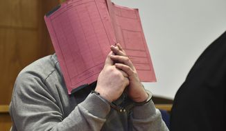 FILE - In this Feb. 26, 2015 file photo  former nurse Niels Hoegel., accused of multiple murder and attempted murder of patients, covering his face with a file at the district court in Oldenburg, Germany. German authorities say Monday Aug. 28, 2017  they now believe that a nurse who was convicted of killing patients with overdoses of heart medication killed at least 84 people. Niels Hoegel was convicted in 2015 of two murders and two attempted murders at a clinic in the northwestern town of Delmenhorst.  Oldenburg police chief Johann Kuehme said Monday authorities have now unearthed evidence of 84 killings. (Carmen Jaspersen/dpa via AP,file)