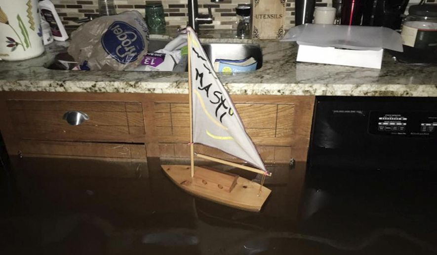 This Sunday, Aug. 27, 2017, photo provided by Ramit Plushnick-Masti, shows a toy sailboat floating in the kitchen of her flooded home in Houston's Meyerland neighborhood that was caused by Tropical Storm Harvey. Plushnick-Masti and her family intended to ride out the storm in their Houston home, but their plan changed when the floodwaters rose over the weekend. (Ramit Plushnick-Masti via AP)