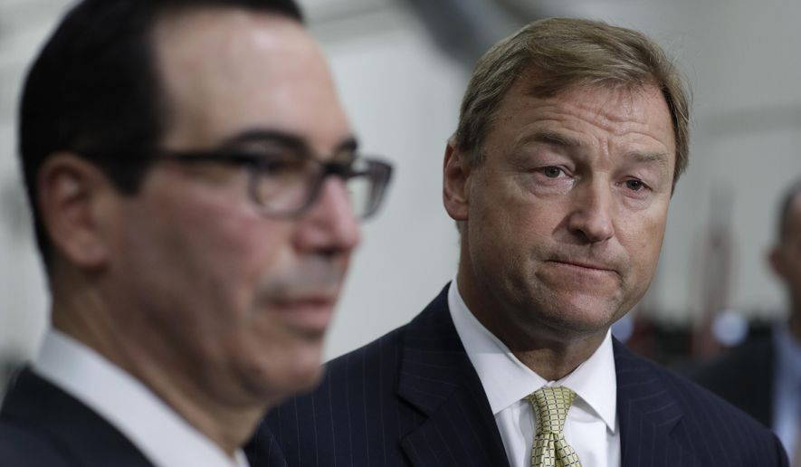 Treasury Secretary Steven Mnuchin, left, and Sen. Dean Heller, R-Nev., listen during a news conference Monday, Aug. 28, 2017, in Las Vegas. (AP Photo/John Locher)