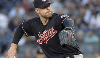 Cleveland Indians pitcher Corey Kluber delivers the ball to the New York Yankees during the first inning of a baseball game, Monday, Aug. 28, 2017, at Yankee Stadium in New York. (AP Photo/Bill Kostroun)
