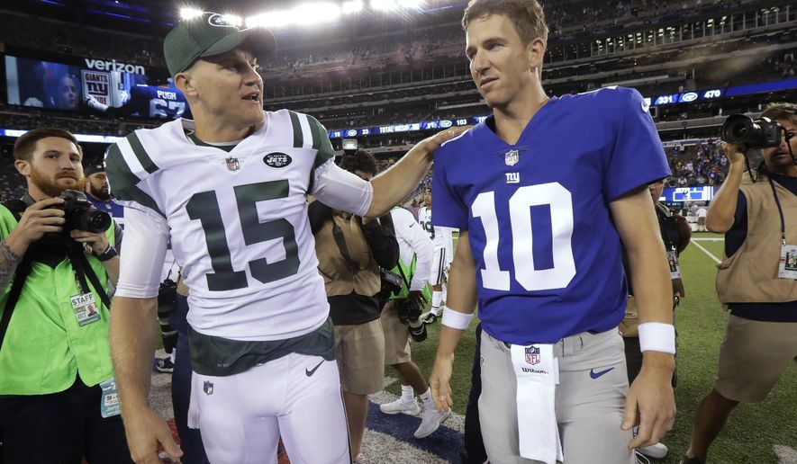 New York Jets' Josh McCown (15) talks with New York Giants' Eli Manning (10) after a preseason NFL football game Saturday, Aug. 26, 2017, in East Rutherford, N.J. The Giants won 32-31. (AP Photo/Julio Cortez)