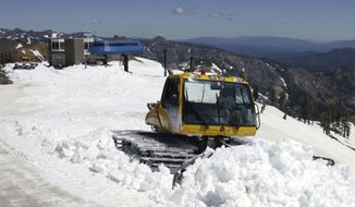 FILE- In this June 30, 2011 file photo, a snow cat grooms one of the trails at Alpine Meadows Ski Resort near Tahoe City, Calif. A ski resort at Lake Tahoe has announced a new partnership with a leading outdoor retailer in China to try to help attract more Chinese skiers and snowboarders to the region. The agreement between Squaw Valley Alpine Meadows and Toread builds on the Sierra resort's existing alliance with China's Genting Resort Secret Garden. (AP Photo/Rich Pedroncelli, File)