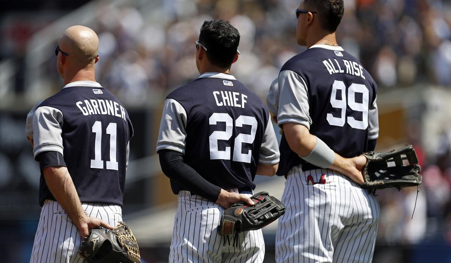 New York Yankees Brett Gardner (11), Yankees Jacoby Ellsbury (22) and Yankees Aaron Judge (99) stand for the national anthem prior to taking on the Seattle Mariners in a baseball game on Saturday, Aug. 26, 2017, in New York. (AP Photo/Adam Hunger)