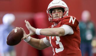 FILE - In this March 11, 2017, file photo, Nebraska quarterback Tanner Lee (13) throws during NCAA college football spring practice in Lincoln, Neb.  After two mediocre years at Tulane and sitting out 2016 because of transfer rules, Lee is the starting quarterback at Nebraska. (AP Photo/Nati Harnik, File)