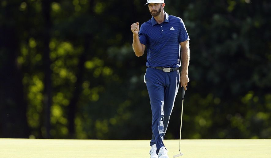 Dustin Johnson reacts on the 15th green after making a birdie putt during the final round of The Northern Trust golf tournament on Sunday, Aug. 27, 2017, in Old Westbury, N.Y. (AP Photo/Adam Hunger)