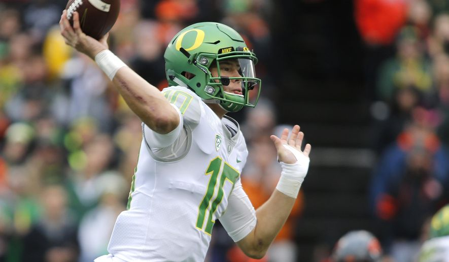 FILE - In this Nov. 26, 2016, file photo, Oregon quarterback Justin Herbert throws in the first half of an NCAA college football game against Oregon State in Corvallis, Ore. Herbert had what was essentially a two-pronged approach to the offseason: Become stronger and become a leader. Oregon opens the season at home on Saturday, Sept. 2, 2017 against Southern Utah. (AP Photo/Timothy J. Gonzalez, File)