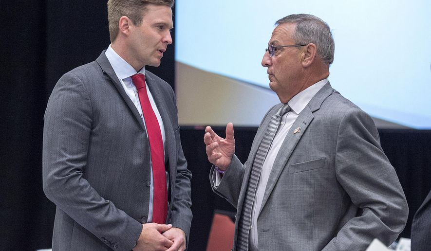 New Brunswick Premier Brian Gallant, left, and Maine Governor Paul LePage chat at the start of a meeting of New England governors and Eastern Canadian premiers in Charlottetown, Prince Edward Island, on Monday, Aug. 28, 2017. (Andrew Vaughan/The Canadian Press via AP)