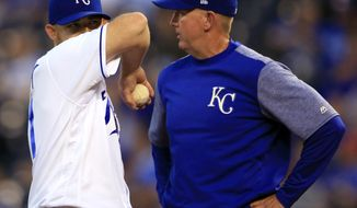 Kansas City Royals starting pitcher Ian Kennedy, left, talks with pitching coach Dave Eiland, right, after giving up a three-run home run during the third inning of a baseball game against the Tampa Bay Rays at Kauffman Stadium in Kansas City, Mo., Monday, Aug. 28, 2017. (AP Photo/Orlin Wagner)