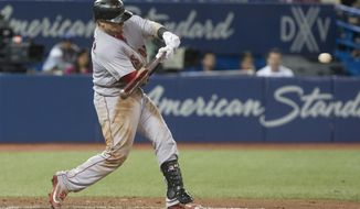 Boston Red Sox' Christian Vazquez hits a two run homer off Toronto Blue Jays relief pitcher Danny Barnes, not shown, during seventh inning Major League baseball action in Toronto on Monday, Aug. 28, 2017. (Chris Young/The Canadian Press via AP)