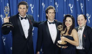 """The cast of the television show """"Seinfeld"""" (l-r) Michael Richards, Jerry Seinfeld, Julia Louise-Dreyfus, and Jason Alexander pose backstage with their awards at the 45th Annual Emmy Awards on Sunday, Sept. 19, 1993 in Pasadena, Calif. (AP Photo/Douglas C. Pizac)"""