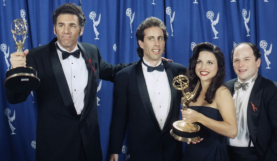 """The cast of the television show """"Seinfeld"""" (l-r) Michael Richards, Jerry Seinfeld, Julia Louise-Dreyfus, and Jason Alexander pose backstage with their awards at the 45th Annual Emmy Awards on Sunday, Sept. 19, 1993, in Pasadena, Calif. (AP Photo/Douglas C. Pizac) ** FILE **"""