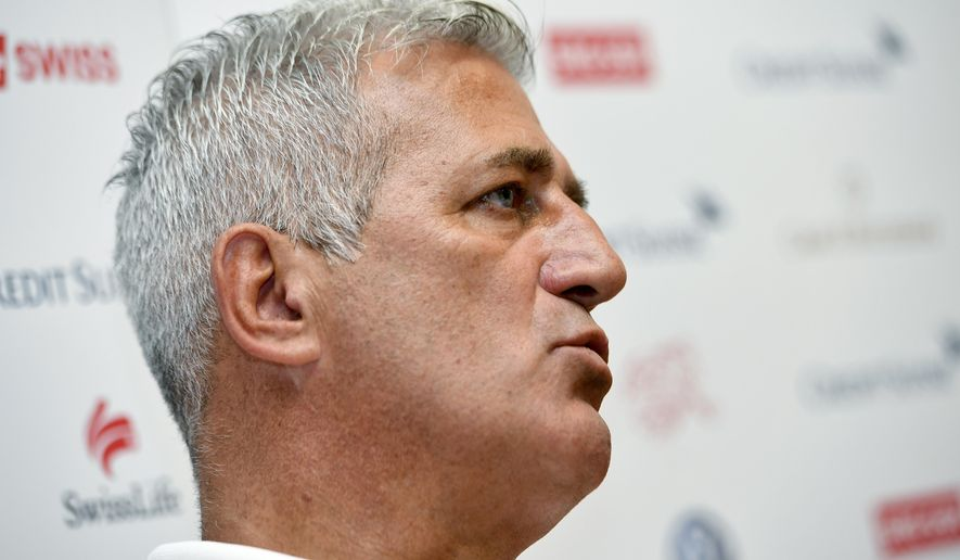 Swiss national soccer team head coach Vladimir Petkovic smiles during a press conference in Feusisberg, Switzerland, Monday, Aug. 28, 2017. Switzerland coach Vladimir Petkovic has signed a two-year contract extension as reward for a perfect record in World Cup qualifying. The Swiss football federation says Petkovic was contacted by clubs after the team's rise to No. 4 in the FIFA rankings. The statement did not identify clubs wanting to hire Petkovic.  (Walter Bieri/Keystone via AP)