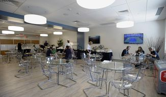 This Saturday, Aug. 26, 2017 photo shows the dining area at the Connecticut Tennis Center at Yale in New Haven, Conn. Officials have begun marketing the venue for conventions and business meetings, part of an effort to get more use out of a stadium that hosts a once-a-year tennis tournament. (AP Photo/Jessica Hill)