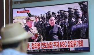 "In this Saturday, Aug. 26, 2017, file photo, a man watches a screen showing an image of North Korean leader Kim Jong Un, at the Seoul Train Station in Seoul, South Korea. Three North Korea short-range ballistic missiles failed on Saturday, U.S. military officials said, which, if true, would be a temporary setback to Pyongyang's rapid nuclear and missile expansion. The banners read: ""South Korean Presidential Office, National Security Director Chung Eui-yong chaired a National Security Council meeting."" (AP Photo/Lee Jin-man, File)"