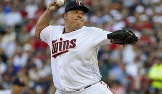 FILE - In this July 18, 2017, file photo, Minnesota Twins starting pitcher Bartolo Colon throws to the New York Yankees in the first inning of a baseball game in Minneapolis. The Twins have entered the final five-week stretch of the season with a surprising hold on the AL's second wild card spot. The peculiar-at-the-time pickup of 44-year-old pitcher Bartolo Colon has proven to be an important part of this surge.(AP Photo/Bruce Kluckhohn, File)