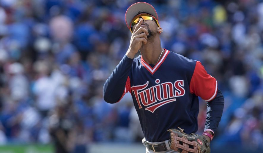Minnesota Twins' Byron Buxton gestures as he runs off the field at the end of a baseball game as his team defeated the Toronto Blue Jays in Toronto, Sunday Aug. 27 2017. (Chris Young/The Canadian Press via AP)