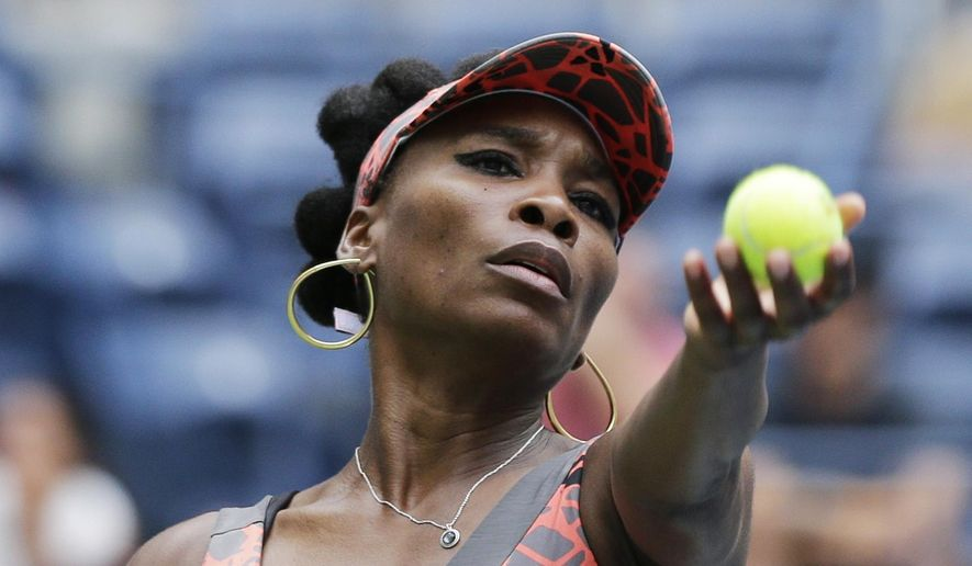 Venus Williams, of the United States, serves to Viktoria Kuzmova, of Slovakia, during the first round of the U.S. Open tennis tournament, Monday, Aug. 28, 2017, in New York. (AP Photo/Seth Wenig)