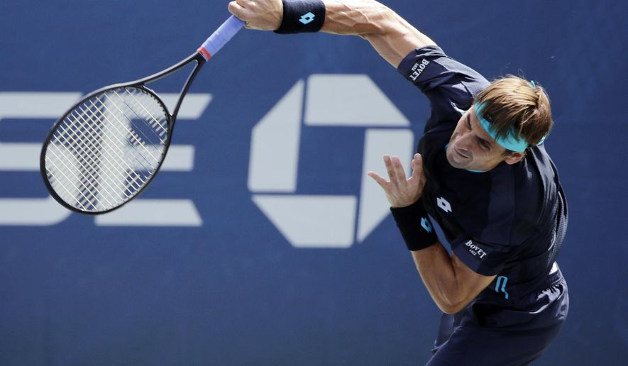 David Ferrer, of Spain, serves to Mikhail Kukushkin, of Russia, during the first round of the U.S. Open tennis tournament, Monday, Aug. 28, 2017, in New York. (AP Photo/Frank Franklin II)