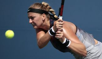 Petra Kvitova, of Czech Republic, returns a shot from Jelena Jankovic, of Serbia, during the first round of the U.S. Open tennis tournament, Monday, Aug. 28, 2017, in New York. (AP Photo/Andres Kudacki)