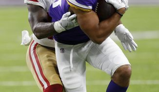 Minnesota Vikings tight end Bucky Hodges (84) tries to break a tackle by San Francisco 49ers linebacker Reuben Foster during the first half of an NFL preseason football game Sunday, Aug. 27, 2017, in Minneapolis. (AP Photo/Jim Mone)