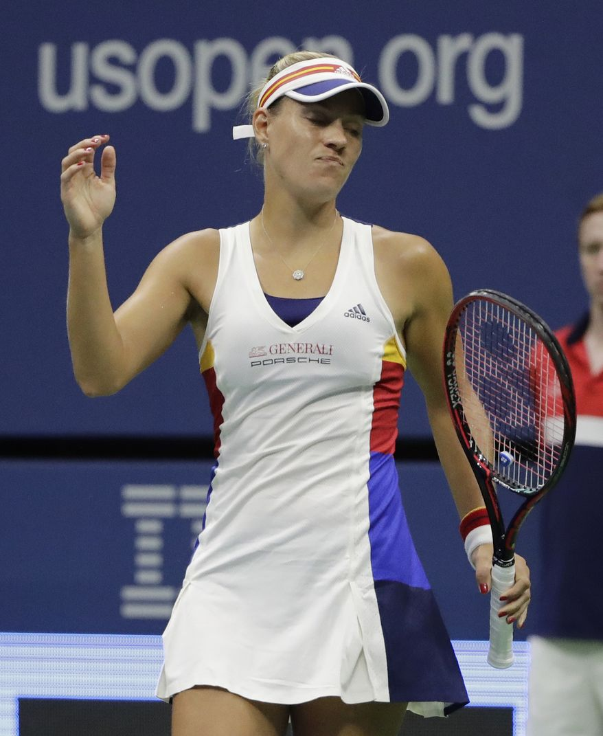 RETRANSMISSION TO PLAYER TO NAOMI OSAKA - Angelique Kerber, of Germany, reacts after losing a point to Naomi Osaka of Japan, during the first round of the U.S. Open tennis tournament, Tuesday, Aug. 29, 2017, in New York. (AP Photo/Frank Franklin II)