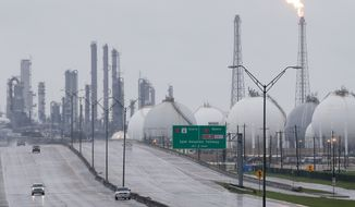 A flares at Shell is shown along with other complexes along 146 Tuesday, August 29, 2017 in Deer Park. Several plants shut down due to Hurricane Harvey. ( Melissa Phillip/Houston Chronicle via AP)