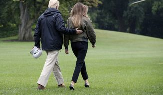 President Donald Trump walks with first lady Melania Trump to Marine One on the South Lawn of the White House in Washington, Tuesday, Aug. 29, 2017, for a short trip to Andrews Air Force Base, Md., then onto Texas to survey the response to Hurricane Harvey. The hurricane is the first major disaster of Trump's presidency.  (AP Photo/Jacquelyn Martin)