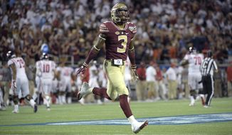 FILE - In this Sept. 6, 2016, file photo, Florida State defensive back Derwin James (3) celebrates after an interception by defensive back Tarvarus McFadden during the second half of an NCAA college football game against Mississippi in Orlando, Fla. Safety Derwin James' first game in nearly a year will be on a big stage. The sophomore safety will have at least one eye glued to Alabama quarterback Jalen Hurts the entire game when the third-ranked Seminoles take on No. 1 Alabama Saturday, Sept. 2, 2017 in Atlanta. (AP Photo/Phelan M. Ebenhack, File)