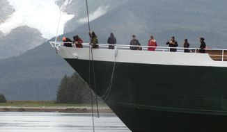 NOAA-trained marine mammal responders collect a sample from the exhalation of a humpback whale, entangled in the anchor line of a small cruise ship, on Sunday, Aug.  27, 2017, near the mouth of Tracy Arm, Alaska. The humpback whale became entangled in the anchor line south of Juneau, getting stuck for roughly 12 hours while federal authorities and the boat's crew worked to free it. (John Moran/NOAA Fisheries via AP)
