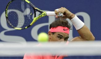 Rafael Nadal, of Spain, returns a shot from Dusan Lajovic, of Serbia, during the first round of the U.S. Open tennis tournament, Tuesday, Aug. 29, 2017, in New York. (AP Photo/Frank Franklin II)
