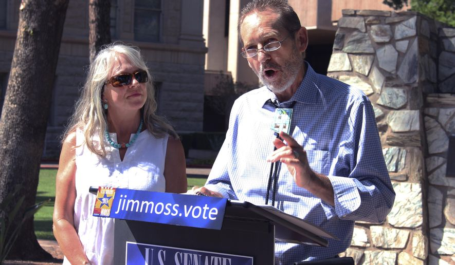 Democrat Jim Moss announces his candidacy for the U.S. Senate alongside his wife, Kelly Moss, at the state Capitol in Phoenix, on Tuesday, Aug. 29, 2017. Moss wants to take on Republican Sen. Jeff Flake next year, but first must get through what is likely to be a crowded Democratic primary. (AP Photo/Bob Christie)
