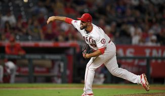 Los Angeles Angels relief pitcher Blake Parker throws to the plate during the ninth inning of a baseball game against the Oakland Athletics, Monday, Aug. 28, 2017, in Anaheim, Calif. (AP Photo/Mark J. Terrill)