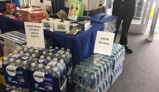 "A now-viral photo showing Dasani water being sold for $43 a case at a Houston Best Buy was ""a big mistake,"" the company said Tuesday. (Twitter/@kenklippenstein)"