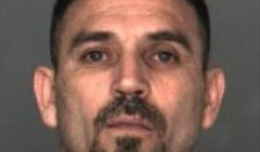 FILE - This undated file photo released by U.S. Customs and Border Protection shows suspect Martel Valencia-Cortez, 39. Valencia-Cortez, a notorious human smuggler who struck a U.S. Border Patrol agent in the face with a rock after a foiled smuggling attempt in California, was sentenced Monday, Aug. 28, 2017 to more than eight years in prison. (U.S. Customs and Border Protection via AP, file)