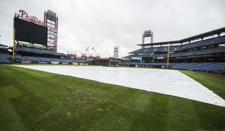 The field is covered prior to the first inning of a baseball game between the Atlanta Braves and the Philadelphia Phillies, Tuesday, Aug. 29, 2017, in Philadelphia. The game was postponed due to rain. (AP Photo/Chris Szagola)