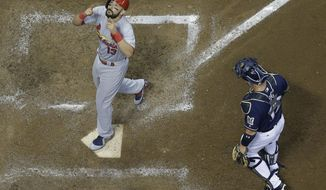 St. Louis Cardinals' Matt Carpenter looks up as he crosses home after hitting a two-run home run during the fifth inning of a baseball game against the Milwaukee Brewers Tuesday, Aug. 29, 2017, in Milwaukee. (AP Photo/Morry Gash)