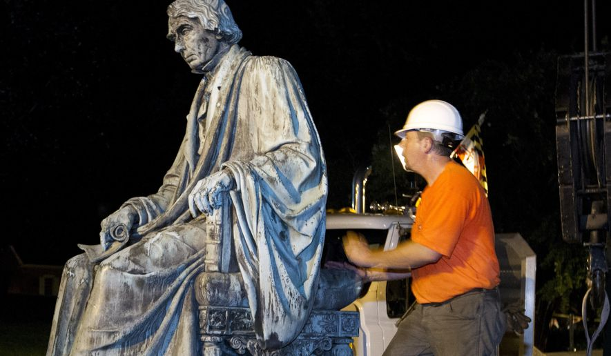 FILE - In a Friday, Aug. 18, 2017 file photo, workers positions the monument dedicated to U.S. Supreme Court Chief Justice Roger Brooke Taney on a flatbed truck after it was removed from outside Maryland State House, in Annapolis, Md.  Maryland's Senate President Thomas V. Mike Miller Jr. says he regrets that his remarks about the late Supreme Court Justice Roger Taney became a distraction. The Washington Post reports that a dozen African American ministers and community activists gathered in Prince George's County Monday, Aug. 28 to condemn Miller Jr.'s defense of the author of the Dred Scott decision. (AP Photo/Jose Luis Magana, File)