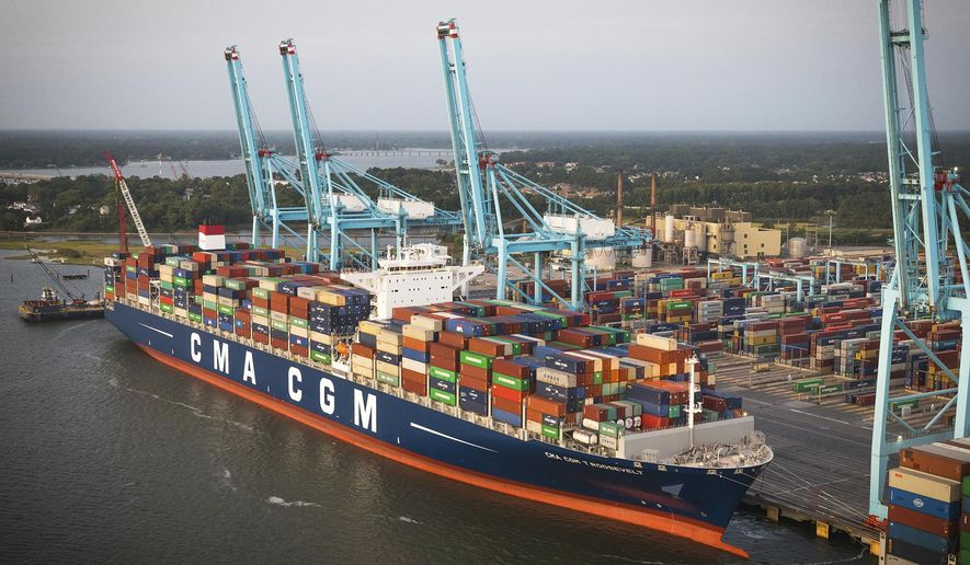 This Monday Aug. 28, 2017 image provided by the Port of Virginia shows the CMA CGM Theodore Roosevelt being unloaded at the Virginia International Gateway in Norfolk, Va. The arrival of the ship breaks the record for largest container ship ever to visit the Port of Virginia and the East Coast. (Keith Lanpher/Port of Virginia via AP)
